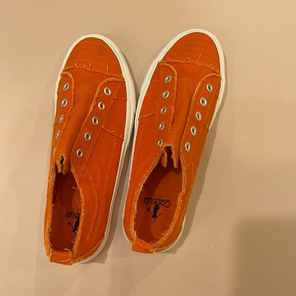 Orange low top sneakers